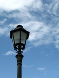 single lamp post against blue sky poster