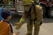 firefighter in uniform with a child - 2245181