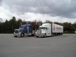 2 freightliner trucks on parkinglot