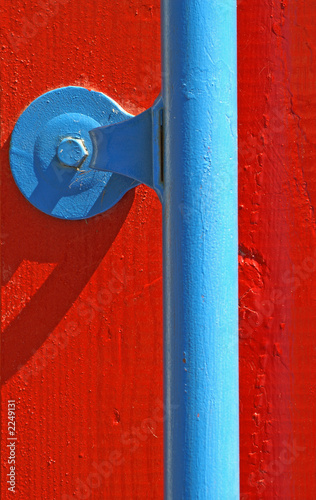abstract/blue rail on red