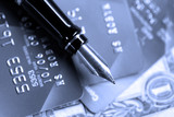 fountain pen on credit cards and us money poster