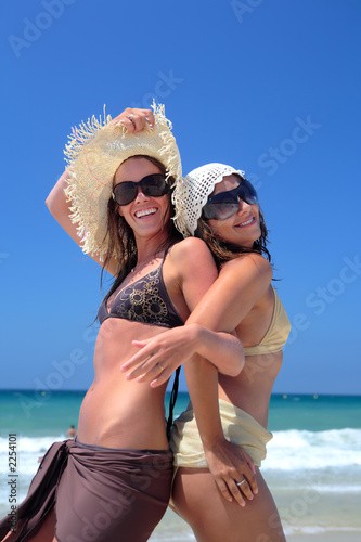 two sexy young girls or friends playing on a sunny