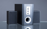 audio speakers on gray background with reflection poster