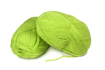 two skeins of green wool yarn.