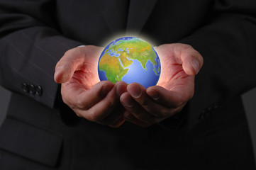 businessman's hands and earth