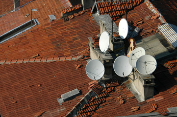 dish antennas on the tiled rooftop