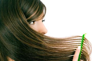 brunette brushes hair