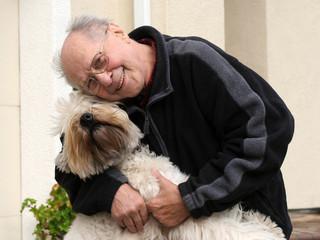 happy senior man and his dog