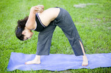 Hispanic woman practising Yoga in the park poster