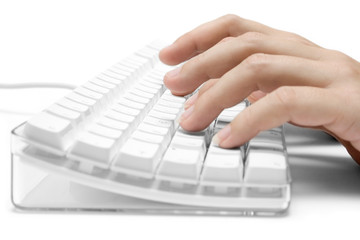 typing on a white computer keyboard