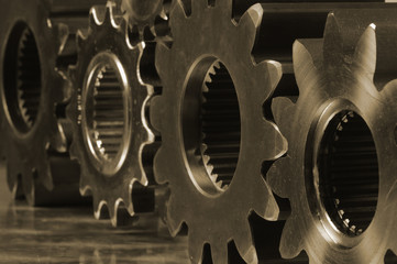 gear and metals in deep sepia toning