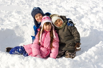 happy young children on snow