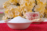 granulated natural sugar in a bowl on the kitchen table poster
