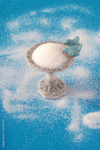 bird feeder sugar bowl on a blue background