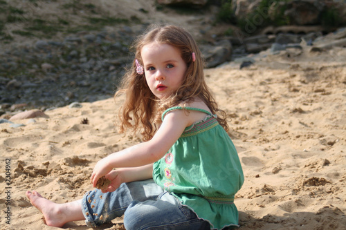 cute girl playing in the sand