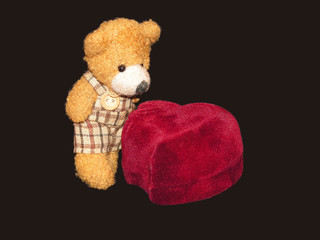 small teddy bear with a ringbox