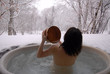 young japanese woman in hot spring