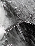 abstract snow and ice over flowing water poster