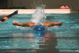 female swimmer swimming butterfly stroke poster