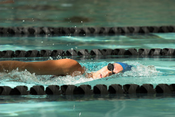 female swimmer swimming freestyle