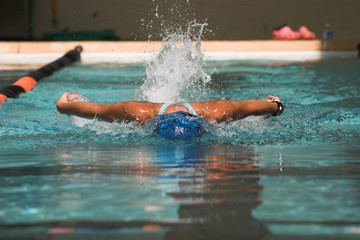 female swimmer swimming butterfly stroke