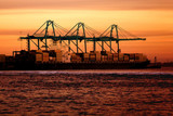 cargo ship at sunset poster