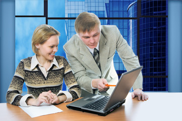 business team man and woman work in office on laptop with view b