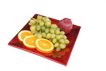 fruit on a red plate
