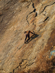 climber on the orange rock