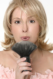 female flowing excess powder from makeup  brush poster
