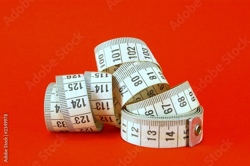measuring tape on red