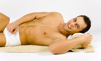 man's lying on the towel