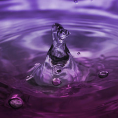 bubbles motion in violet water.