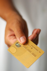 hand with a gold credit card