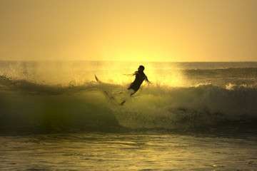 sunset surfer falling