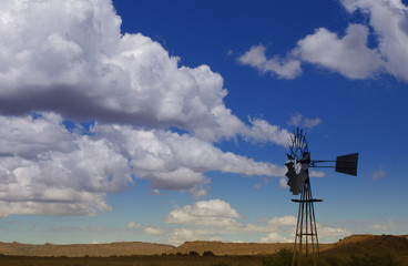 windmill against clouds