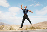 excited business man jumping in the air poster