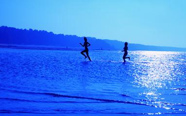 running girls over blue