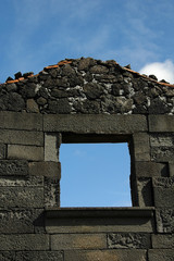 window of a house in ruins in the azores