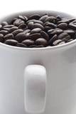 coffee cup full of coffee beans poster