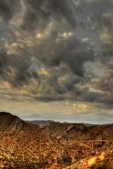 desert storm approaching a bridge