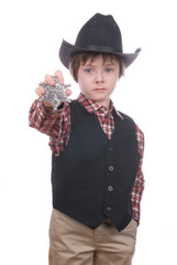 young sheriff boy holding a marshals badge