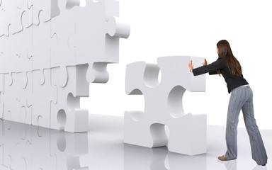 business teamwork - businesswoman building a puzzl
