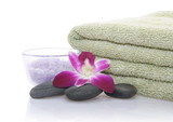green towel, orchid, bath salt and pebble