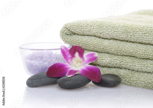 green towel, orchid, bath salt and pebble - 2388138