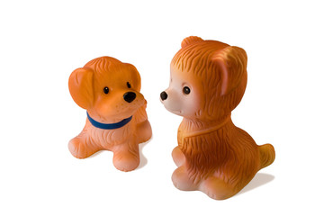 two rubber toy dogs