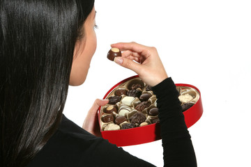 woman eating valentines chocolate