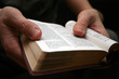 young man reading small bible - 2397706