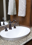 fancy sink with hand towel poster