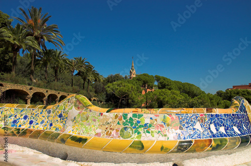 antoni gaudi hause and ceramic bench in park guell